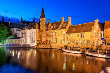 Dock of the Rosary (Rozenhoedkaai) at twilight, a scene from a medieval fairytale in Bruges, Belgium