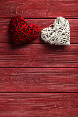 Love hearts on a red wooden background
