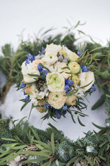 Beautiful wedding bouquet with spruce scarf