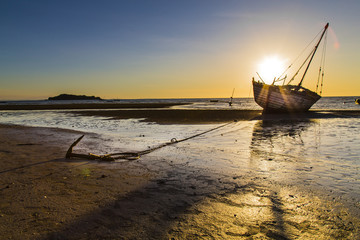 Stranded ship anchored on a sunset in Madagascar