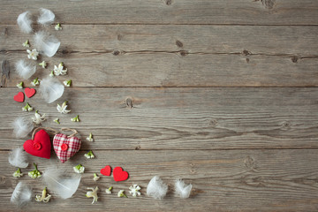 Wooden background with red hearts and flowers
