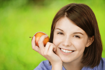 portrait of young charming woman with apple