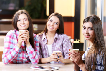 Beautiful girls in cafe
