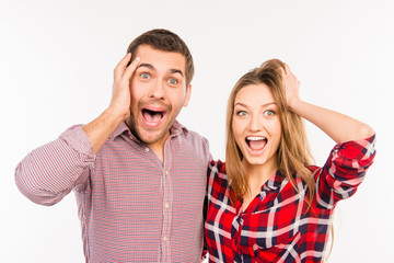 Funny cheerful couple showing surprise