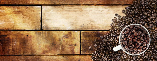 Coffee beans and light on wood background