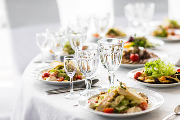 Empty glasses  in restaurant. Banquet table set