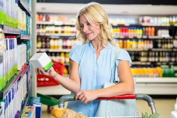 Beautiful woman holding product