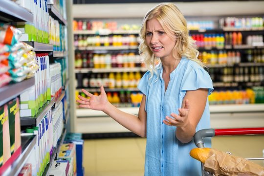 Confused woman doesnt know what to buy