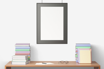 Blank picture frame hanging on a wooden table with books, mock u