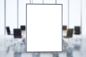 Blank picture frame at conference room background, mock up