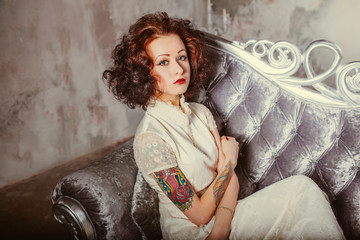 retro fashion portrait photo of young tattooed girl with piercing