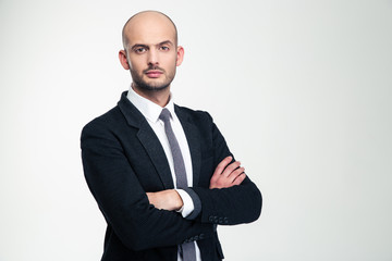 Handsome confisent businessman in black suit standing with folded hands