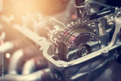Chain in cut metal car engine part
