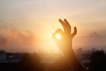 hand in the sunset, one sign of meditation in buddhism, soft  focus
