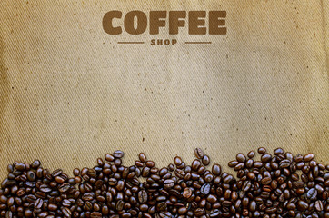 Coffee beans on old fabric texture background