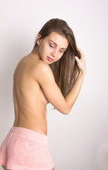 sexy backside of a young woman wearing pink shorts