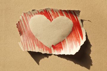 Postcard with one handmade red heart on grunge background
