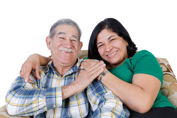 Happy Mexican senior with smiling daughter