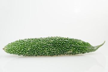 Green bitter gourd on white background