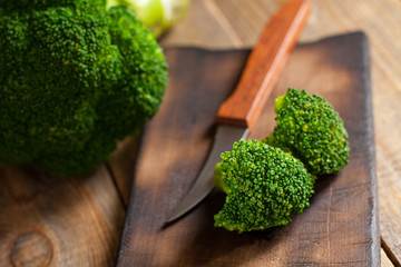 Raw green broccoli on wooden background