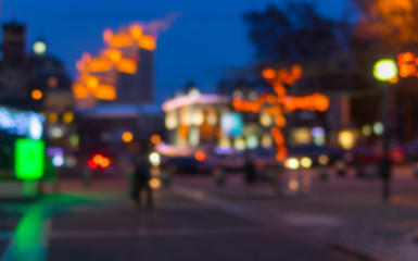 Blurry background - evening illumination in central part of Dnepropetrovsk city at winter time