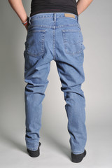 on a guy wearing jeans; view of the waist; guy in the jeans and socks...