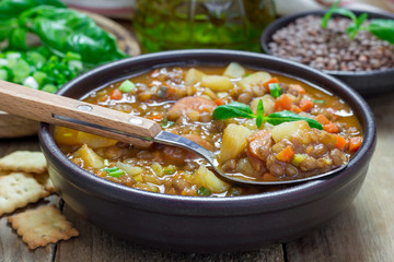 Homemade soup with lentils and sausages