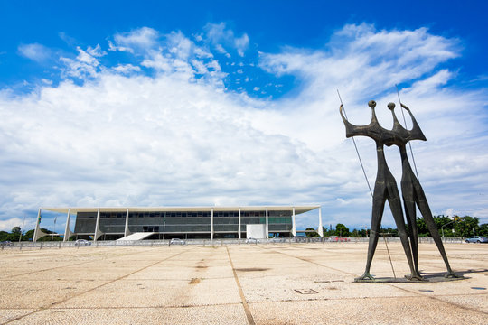 Dois Candangos Monument and Planalto Palace in Brasilia, capital of Brazil.