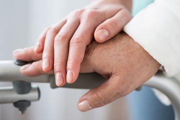 Senior and helpful hand