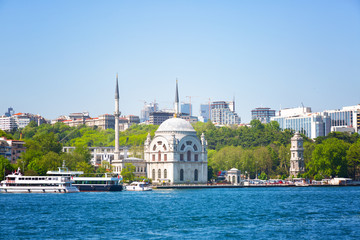 Beautiful small mosque stands on the banks of the Bosphorus, Istanbul