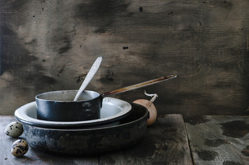Rustic still-life with vintage kitchen utensils on old wooden background