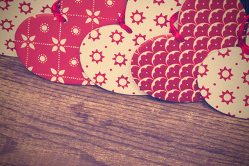 Valentines Day background, red and white hearts on wooden backgr