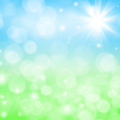 Abstract bright spring background with blurry grass and sky