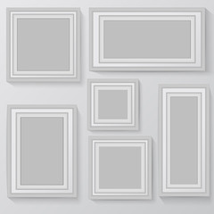 Set of white photo frames on grey background
