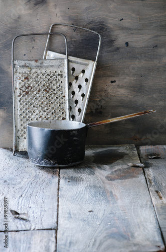 Rustic still life with vintage kitchen utensils on old for Antique kitchen utensils identification
