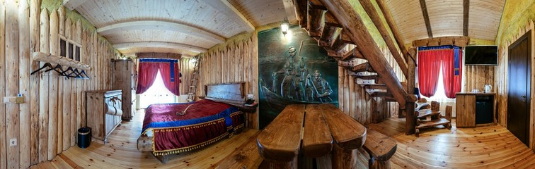 Unique ethnic interior. Traditional, national, design. The hotel room. Ukrainian style and specific decorations of Cossacks historical period. Europe, Ukraine, Carpathians, Hotel History.