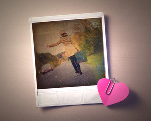 Blank instant photo and small red paper heart.