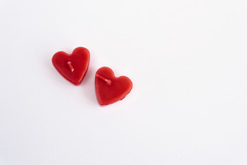 two heart red candles isolated on white background, valentine gr