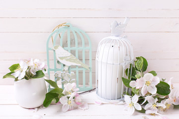 Background with tender apple blossom and candle in decorative bi