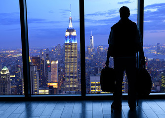 Silhouette man looking at Manhattan by night