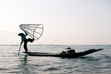 Myanmar travel destination background. Inle Lake fisherman