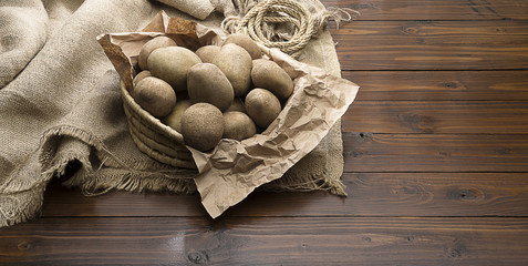 Potatoes over Brown Wooden Background
