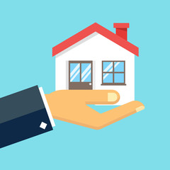 Hand holding house illustration.