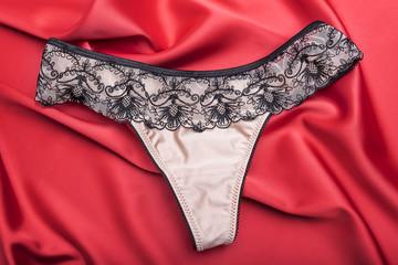 Women's panties on red satin.