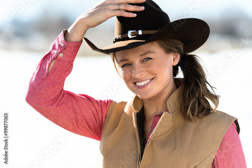 quotcowgirl adjusting hatquot stock photo and royaltyfree
