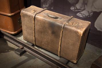 Vintage suitcase on grey background