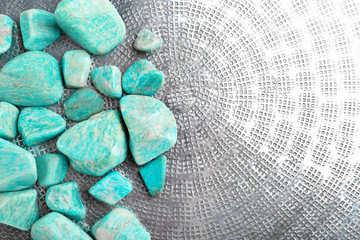 Beautiful mineral stones on glass surface