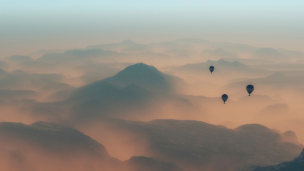 Hot air balloons flying over misty mountain range.