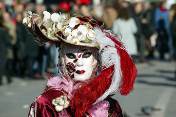 Costumed person Venetian mask during Venice Carnival