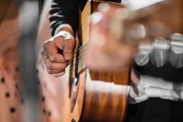 Closeup hand playing acoustic guitar